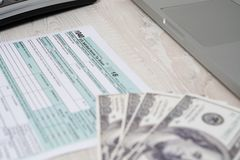 US tax form 1040 with dollar bills. tax form in focus. tax form law document usa white business concept stock images
