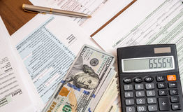 Us tax form with dollar and calculator Royalty Free Stock Image