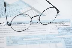 US tax form and glasses. Finance concept royalty free stock photography