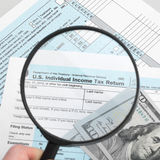 US Tax Form 1040 with magnifying glass - 1 to 1 ratio Stock Image