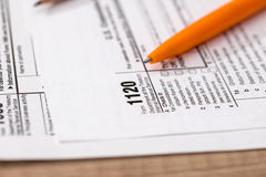 US 1120 tax form royalty free stock images