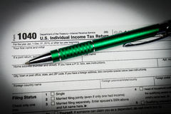 US tax form 1040 with pen and calculator. Tax form law document, Stock Photo