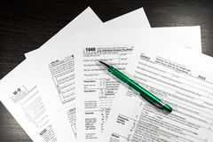 US tax form 1040 with pen and calculator. Tax form law document, Stock Photography