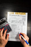 US tax form 1040 with pen and calculator. tax form law document Royalty Free Stock Photography