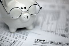 US Tax forms with piggybank. Showing form 1040 Royalty Free Stock Photos