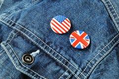 US-und Großbritannien-Tasten auf einer Denim-Jacke Lizenzfreie Stockbilder