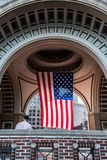 US Veteran looking at Big US american Stars Stripes Flag Hanging from inside Dome in Boston Massachusetts on sunny day Royalty Free Stock Photos