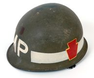 US Vietnam war steel helmet. M1 combat steel helmet from the Vietnam war. American Military police, 28th infantry division logo to the side Stock Photography