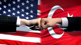 US vs Turkey conflict, international relations crisis, fists on flag background. Stock photo stock photography