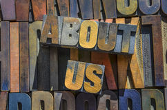 About Us Wooden typeset. The words about us spelt out using wooden type for letterpress printing royalty free stock image