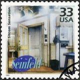 USA - 2000: ägna Seinfeld, televisionkomedi, showsituationskomediförnimmelsen, serie firar århundradet, 90-tal Royaltyfri Bild