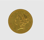 USA $20 gold antique coin. 1850 dated USA circulated gold coin feturing Lady Liberty and thirteen stars isolated on white Royalty Free Stock Photography