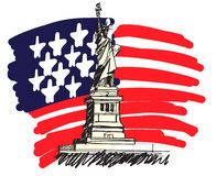 USA. Statue of Liberty with a large american flag in the background Stock Photo