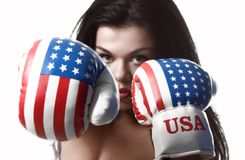 USA. A girl with boxing gloves punching me royalty free stock images