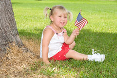 USA. Adorable little girl in red white and blue with flag Royalty Free Stock Photo