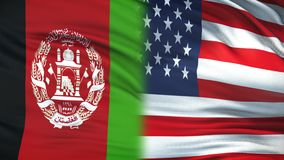 USA and Afghanistan politicians exchanging top secret envelope, flags background. Stock footage stock illustration