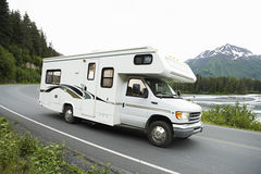 USA, Alaska, Recreational Vehicle Driving On Road Royalty Free Stock Photos