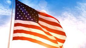 USA American Flag. Beautiful glowing footage of the American Flag flowing in the wind with a golden sunset in the background and a blue sky with white puffy stock video
