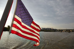 USA. American Flag at a boat in river view Stock Photos