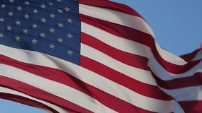 USA American Flag. American flag is flying in the wind on a sunny day. Symbol of the Amenrican national holiday. Shooting close-up. Independence Day - American stock footage