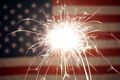 USA American flag lit up by sparklers for 4th of July. Celebrations Royalty Free Stock Images