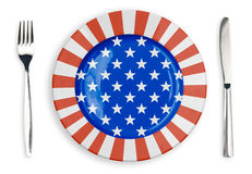 USA or American flag  plate, fork and knife top view. Isolated Royalty Free Stock Photos