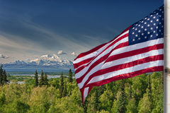 Usa American flag stars and stripes on mount McKinley Alaska background. Usa American flag stars and stripes on snowy mount McKinley Alaska background royalty free stock photo