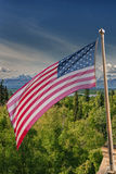 Usa American flag stars and stripes on mount McKinley background Stock Photos