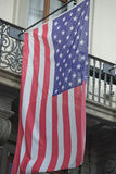 Usa American flag waving from italian balcony Stock Photo