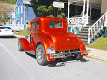 USA: Antiker Motor- Ford de Luxe Rumble Seat 1931 Coupé (hintere Ansicht) Lizenzfreie Stockbilder