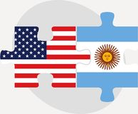 USA and Argentina Flags in puzzle Royalty Free Stock Photo