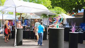 USA, Arizona/Tempe: Glass Artist, Products, Customers. The artists for the biannual Tempe Festival of the Arts are carefully selected. They basically come from Stock Images