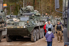USA army Dragoon Ride. Dragoon Ride - USA army crossing Baltic states, Eastern Europe. First stop at Latvia near Jelgavkrasti. Local people are admiring USA Royalty Free Stock Image