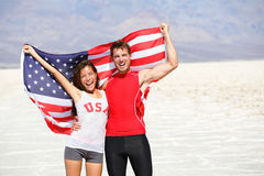 USA athletes people holding american flag cheering. Sports men and fitness runner women celebrating winning after running. Happy young multicultural fitness stock photo