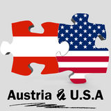 USA and Austria flags in puzzle Royalty Free Stock Photo