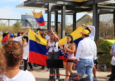 USA, AZ: Rally For Venezuela >Woman Cheering Crowd. Americans of Venezuelan roots convened for a protest rally in Tempe on Sat. February 22, 2014, to support Royalty Free Stock Image