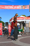 USA, AZ/Tempe: Festival Entertainer - Stilt Walker In Bird  Costume Royalty Free Stock Images