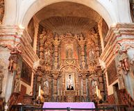 USA, AZ/Tucson - San Xavier del Bac/Main Altar. The retable or altar background, considered the finest example of Spanish retable north of Mexico, is divided Royalty Free Stock Photo