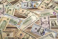 USA bank notes on weathered wood background Royalty Free Stock Photography