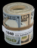 USA Banknote roll 1040 form rubber band isolated black Stock Image