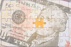 USA banknotes jigsaw puzzle on Gold bitcoin, Missing jigsaw puzz. Le pieces .Key for success concept Stock Photos