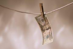 USA-Bargeld auf Wäscheleine Lizenzfreie Stockbilder