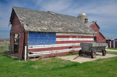 USA Barn. Historic Town old farming equipment and lumber house Stock Photos