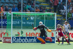 USA beats England during the Hockey World Cup 2014. THE HAGUE, NETHERLANDS - JUNE 1: The ball shot by team USA on its way to the goal. The goalkeeper of England royalty free stock images