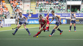 USA beats England during the Hockey World Cup 2014. THE HAGUE, NETHERLANDS - JUNE 1: USA fieldplayer Gonzales is playing the bal towrads the goal during the stock images