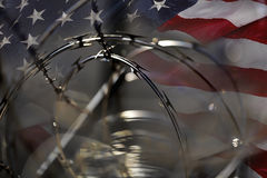 USA Border fence barb razor wire and American Flag Immigration C Stock Photo