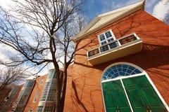 06.04.2011, USA, Boston: Harvard University, Aldrich. Panorama sunny day wide angle clouds green doors entrance trees bottom view nobody, landmarks brick wall Stock Photos