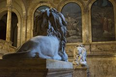 Lions on the staircase of Boston Pubic Library. At the turn of t. USA, Boston - January 2018 - Lions on the staircase of Boston Pubic Library. At the turn of the royalty free stock photo