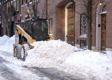 Snowploughs clear the street of snowfall in the Beacon Hill dist stock image