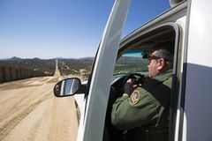 USA - California - Campo - the wall. USA - California - Campo - a border patrol agent watch and control the fence royalty free stock photos